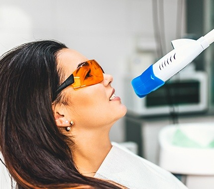 Woman receiving in-office teeth whitening treatment