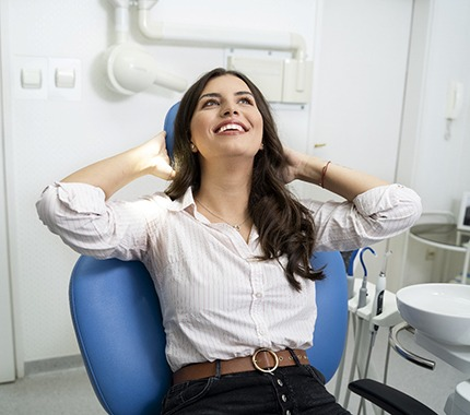 Woman smiles while visiting her Hillsboro sedation dentist