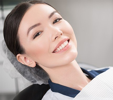 Woman with healthy smile in dental chair